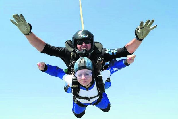 This Is Wiltshire: Instructor Ed Bowyer with a skydiving supporter of the air ambulance