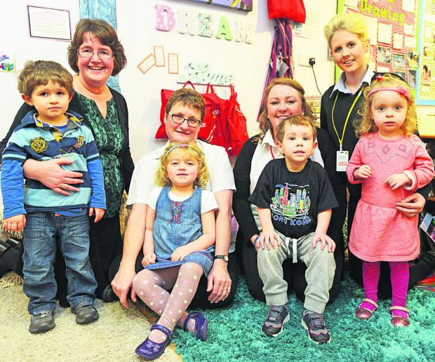This Is Wiltshire: Youngsters at Windmill Hill Day Nursery celebrate their Ofsted report with staff members Angela Farmery, Fay Taylor, Amiee Corcoram and Emma Kingsley