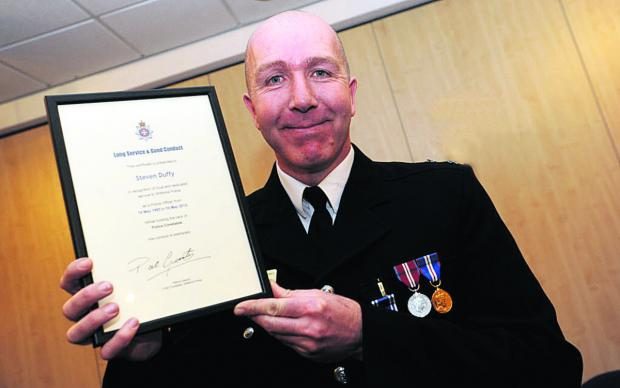 This Is Wiltshire: Steve Duffy with his Long Service and Good Conduct Award