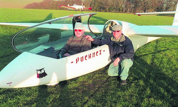 This Is Wiltshire: Roy Sims after his flight, with instructor John Hull