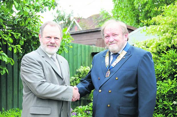 This Is Wiltshire: Trowbridge Lions have elected Graeme Dunn as their president for 2014. He is pictured  receiving the chain of office from outgoing president Robert Foubister.