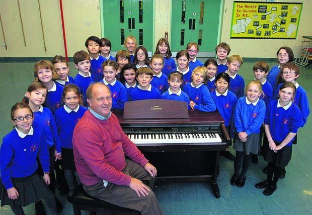 This Is Wiltshire: Headteacher Nick Bowditch with the school choir