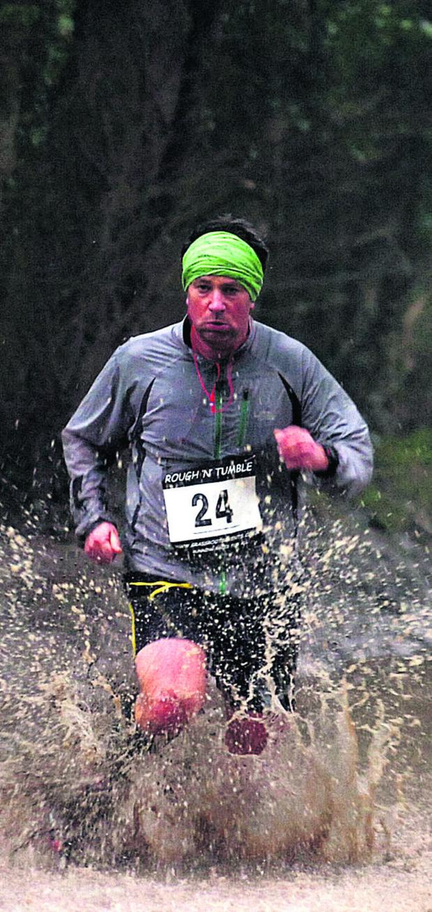 This Is Wiltshire: It's tough going through a  flooded area for competitor Martin Walker in Sunday's Rough n Tumble multi-terrain race in Milton Lilbourne Picture by Paul Morris (PM984-04)