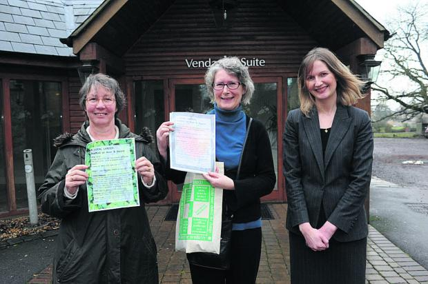 This Is Wiltshire: Climate Friendly Bradford on Avon's Ros Edwards and Sue Thomson get set for the show at Leigh Park, with the help of hotel events manager Louise Rathband
