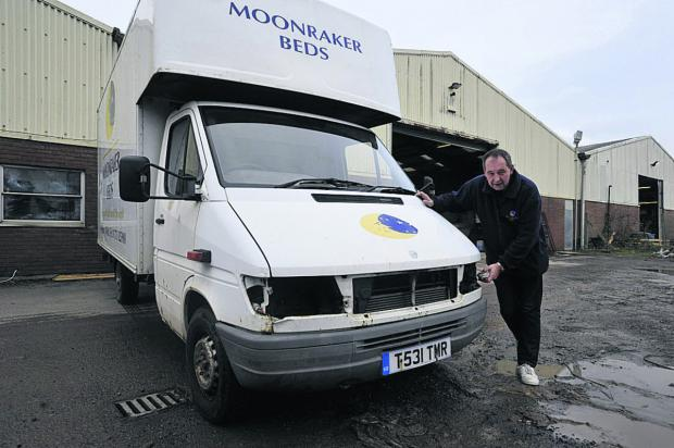 This Is Wiltshire: Moonraker Beds sales director Andy Lewis surveys damage to t
