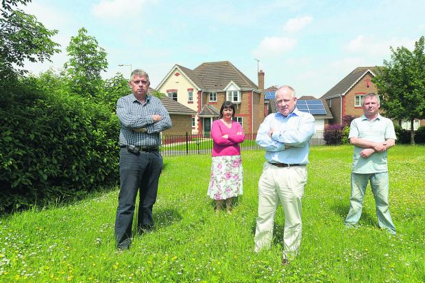 This Is Wiltshire: Residents are complaining about Thames Water's plans to build two sewage tanks on Queen Elizabeth Drive. Pictured are Andrew Hargreaves, Linda Hayes, Brian McLean and Roland Hayes