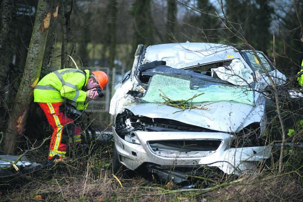 This Is Wiltshire: The wreckage of the Volvo which crashed into a tree in Kingsdown Road