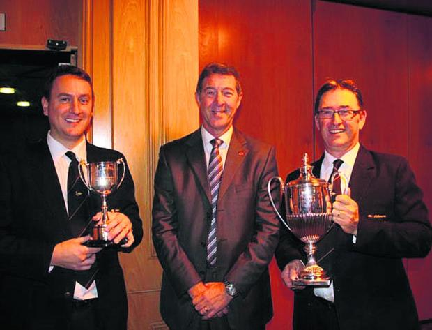 This Is Wiltshire: Winning soloist Richard Hughes, left, with adjudicator Derek Renshaw and James Sheppard