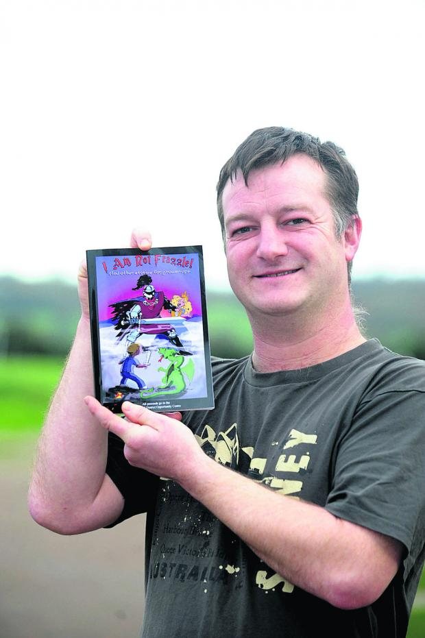 This Is Wiltshire: Dad Darren Worrow with a copy of I Am Not Frazzle