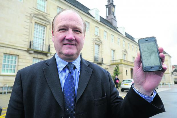 This Is Wiltshire: Coun Philip Whitehead with the new app, which he promises will be improved