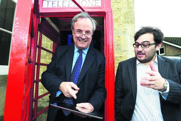 This Is Wiltshire: MP James Gray opening the digital and wi-fi phone box in Purton with Ben Wildeboer, the business development manager of Lde Digital Services
