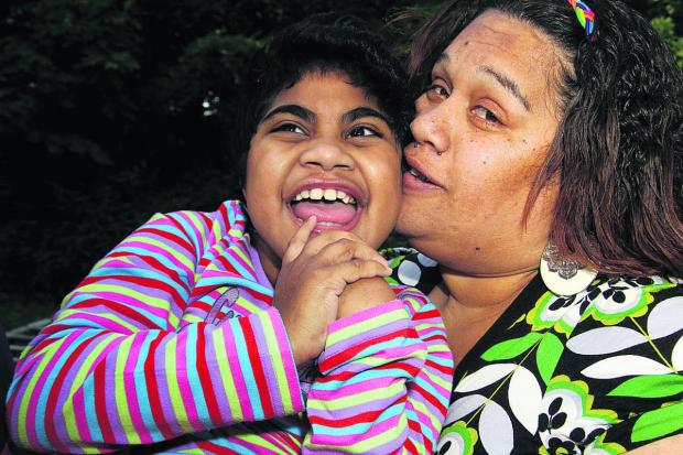 This Is Wiltshire: Louisa Ravouvou and her mother Ana. Louisa has been awarded £5m after both GWH and the John Radciffe Hospital, in Oxford, admitted failures of care