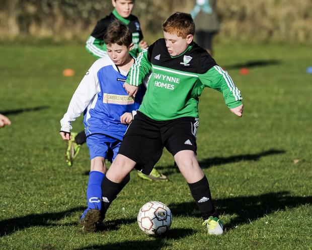 This Is Wiltshire: Jack Brain and Joe McGrogan battle for the ball