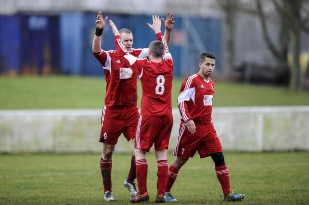 This Is Wiltshire: Supermarine Sports Club's Dave Rendle celebrates with Lee Ha