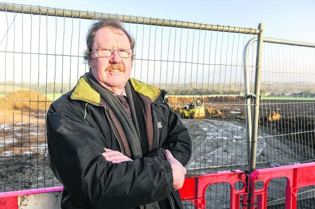 This Is Wiltshire: Richard Symonds outside the Ridgeway Farm development, which he is against