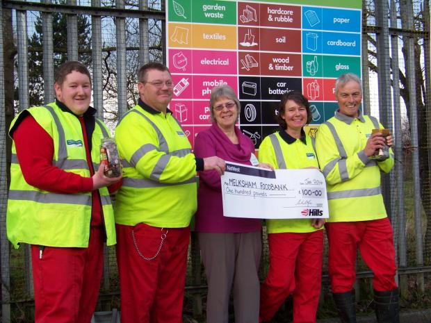 This Is Wiltshire: Hills staff hand over the check to Maureen Vince, of the Melksham Foodbank