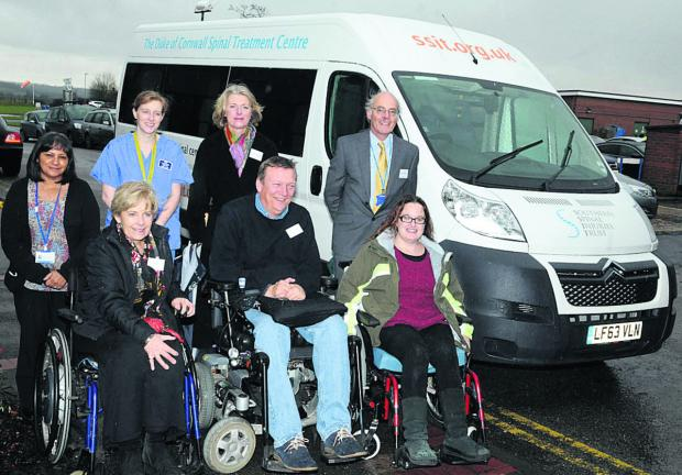 This Is Wiltshire: Staff and patients with the new minibus at the Duke of Cornwall Spinal Treatment Centre