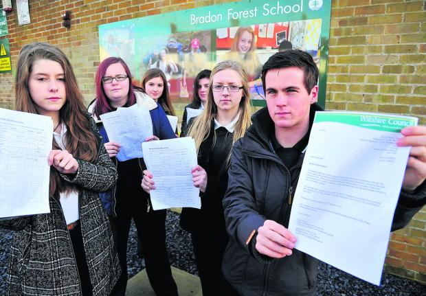 This Is Wiltshire: Students from Bradon Forest School are collecting a petition to save the 53 bus service. From left, Molly Griffin, Sophie Harflett, Eleasha Kell, Charlotte Butler, Lucy Taylor and Gus Gardener