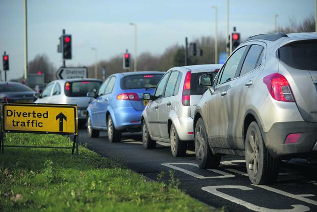 This Is Wiltshire: Traffic queueing along Thames Down Drive