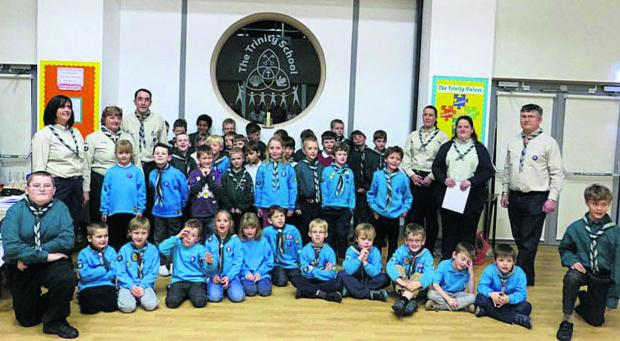 This Is Wiltshire: Beavers, Cubs, Scouts and leaders of 6th Devizes Scout Group at their new home, The Trinity School