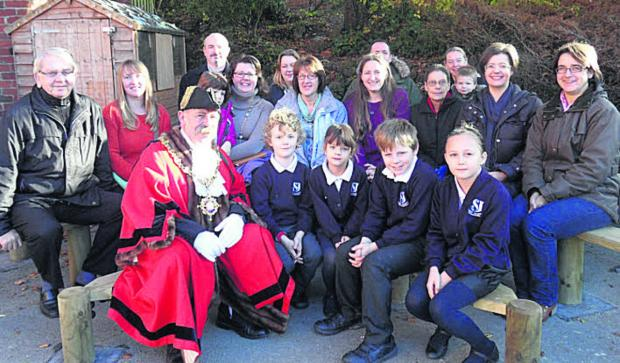 This Is Wiltshire: Devizes mayor Pete Smith officially opens the new play area at St Joseph's School