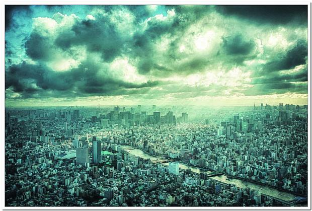This Is Wiltshire: Kevin Mullins is celebrating after being named Landscape Photographer of the Year for this picture of the Tokyo skyline