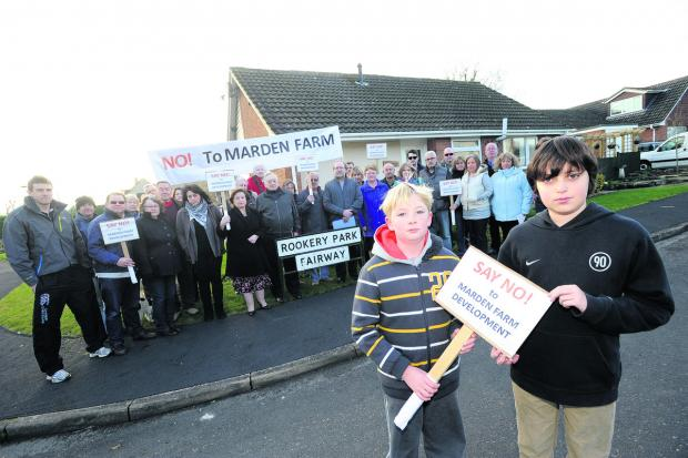This Is Wiltshire: Members of the South Calne Residents Association at an earlier protest against the factory plan