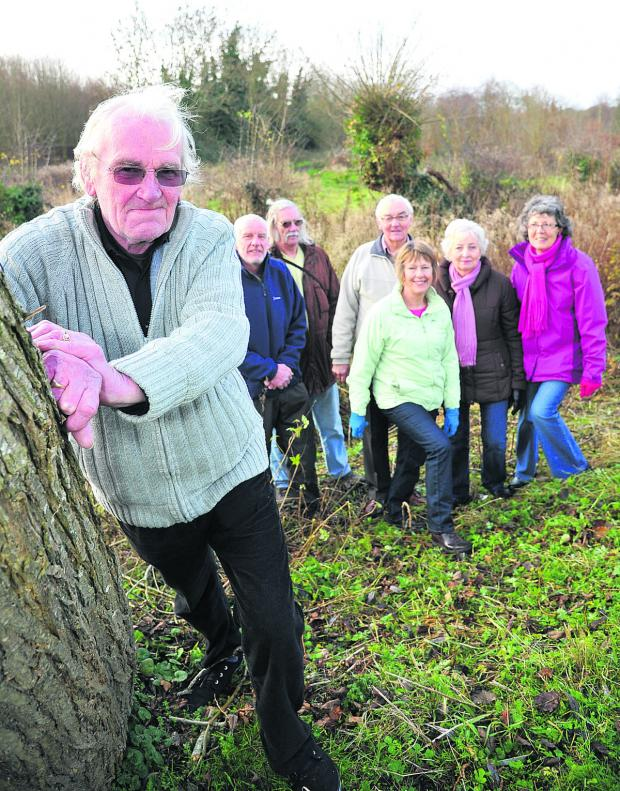 This Is Wiltshire: Some of the successful team behind the campaign which has raised the money to buy Kings Farm Wood in Wroughton. Pictured, left to right, are chairman of Wroughton Parish Council Paul Hurst, parish councillor Steve Harcourt, secretary of Vision for Wrought