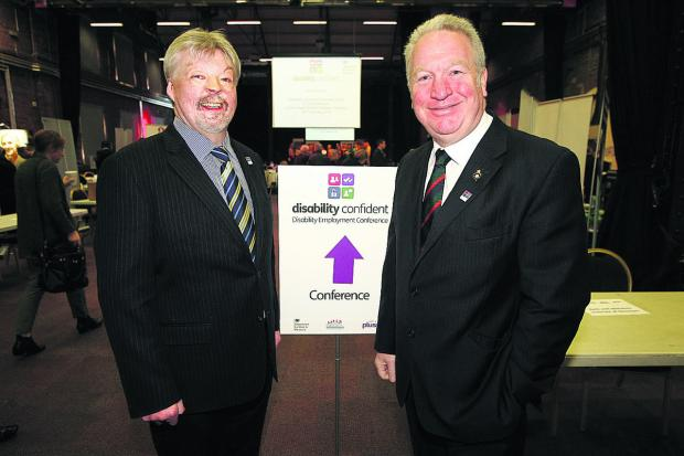 This Is Wiltshire: Minister of State for disabled people Mike Penning and Falklands veteran Simon Weston at the conference