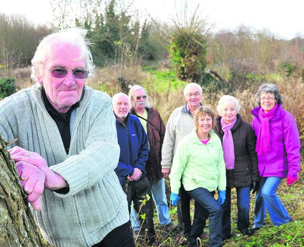 This Is Wiltshire: Members of Wroughton Parish Council and campaigners who are are raising money to buy Kings Farm Wood. From left, parish council chairman Paul Hurst,  parish councillor Steve Harcourt, the secretary of Vision For Wroughton Brian Tildesley, the chairman of