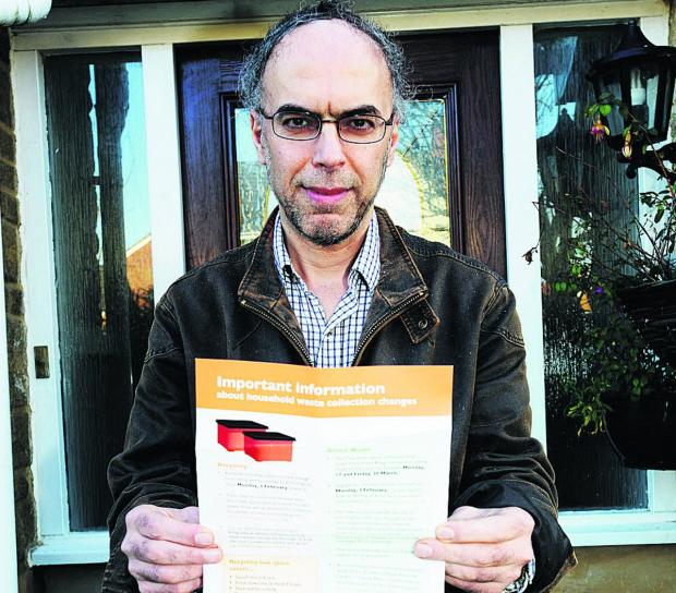 This Is Wiltshire: Ahmad Sadjadian with his green waste and the flyer sent out by Swindon Council
