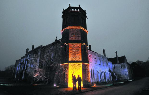 This Is Wiltshire: Visitors admire illuminated Lacock Abbey last year