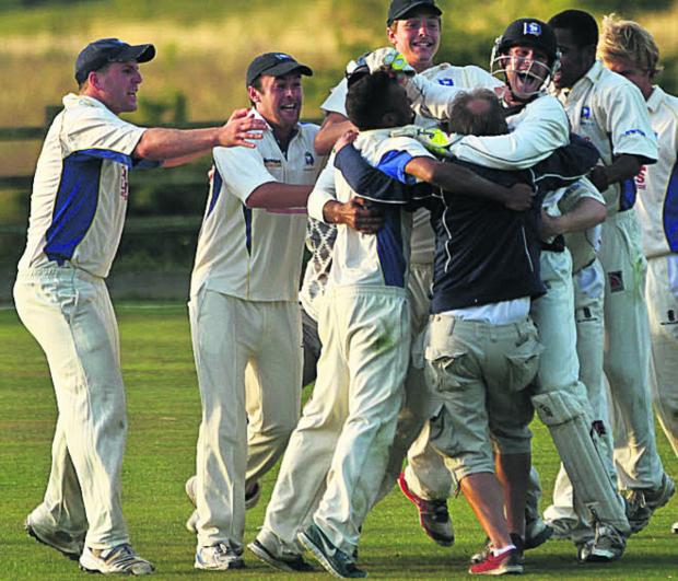 This Is Wiltshire: Potterne celebrate their last-day win over Lechlade that saw them promoted last summer (Picture: Johnathan Rose)