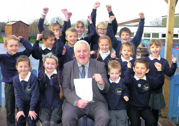This Is Wiltshire: Headteacher Andrew Marsh-Ballard and pupils celebrate their Ofsted success