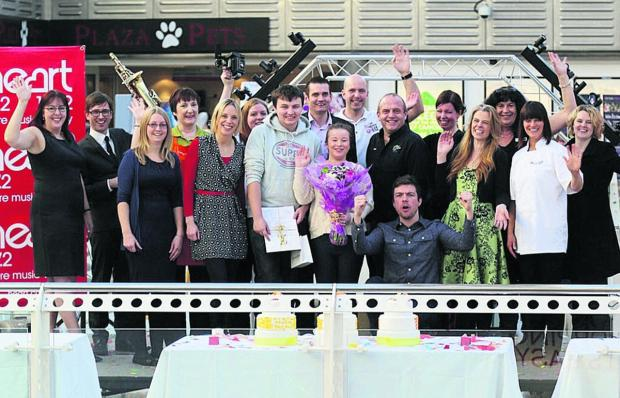 This Is Wiltshire: Man and Fran, standing centre, celebrate their win with competition sponsors