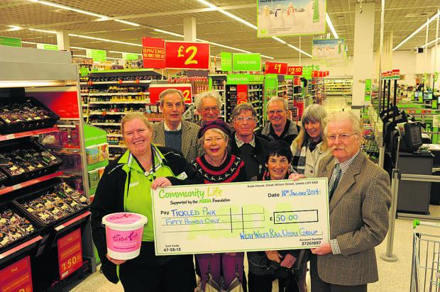 This Is Wiltshire: Nicky Philips of ASDA receives a cheque from West Wiltshire Rail Users Group chairman Roger Newman and members Janet Repton, Rosie Buchan, David Walden, Michael Balfe, Chris Wilding, Horace Prickett and Carrie White