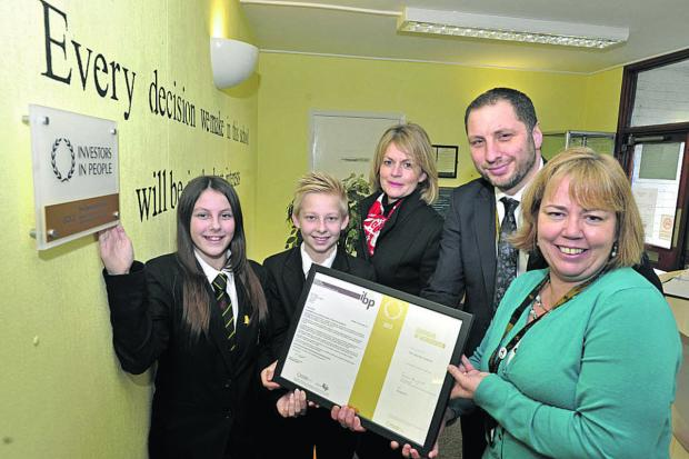 This Is Wiltshire: Clarendon Academy principal Mark Stenton, assistant principal Harriet Clarkson, right, chairman of governors Lizzie Rowe and pupil representatives Victoria Burden and Joe Rendle