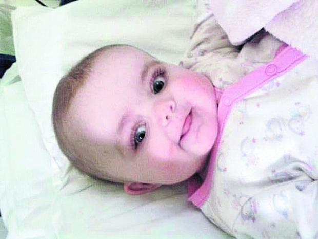 This Is Wiltshire: Little Amelia Harrington at King's College Hospital in London