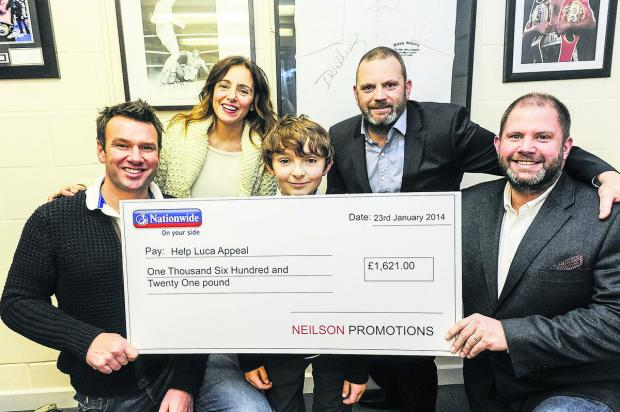 This Is Wiltshire: Neilson Promotions presenting a cheque for £1,621 to Luca Railton towards his operation. From left, Alex Railton, Teresa Railton, Luca Railton, Mark Neilson and Tony Neilson