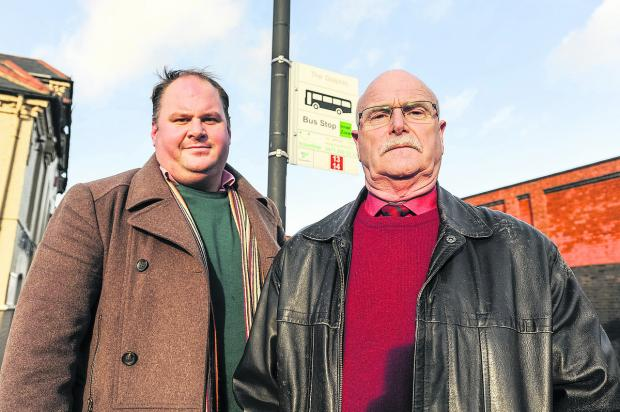 This Is Wiltshire: From left, Coun Jim Robbins, and Coun Peter Watts at the number 13/14 bus stop in Rodbourne Road by the Dolphin Pub