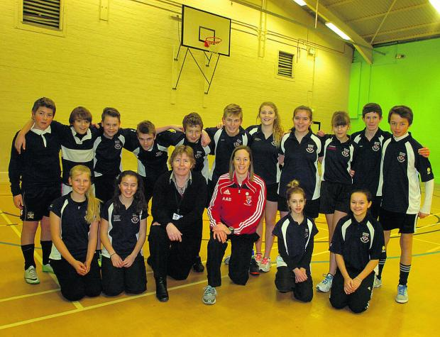 This Is Wiltshire: Department head Sue Marshall and faculty head Ali Beck celebrate with Devizes School students
