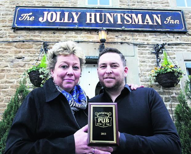 This Is Wiltshire: Helen and Simon Curtis are toasting success after their pub The Jolly Huntsman at Kington St Michael was named the Gazette and Herald pub of the year