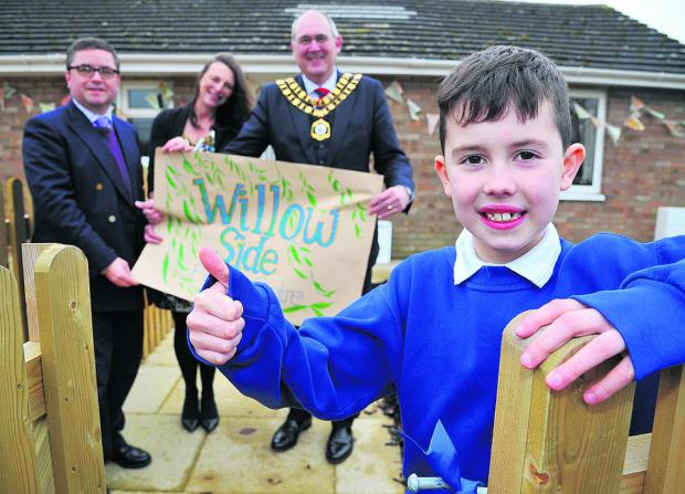 This Is Wiltshire: MP Robert Buckland, headteacher Sue Cox, mayor Nick Martin and pupil Ben Evans at the opening of the new family learning centre and community room at Wroughton Junior School
