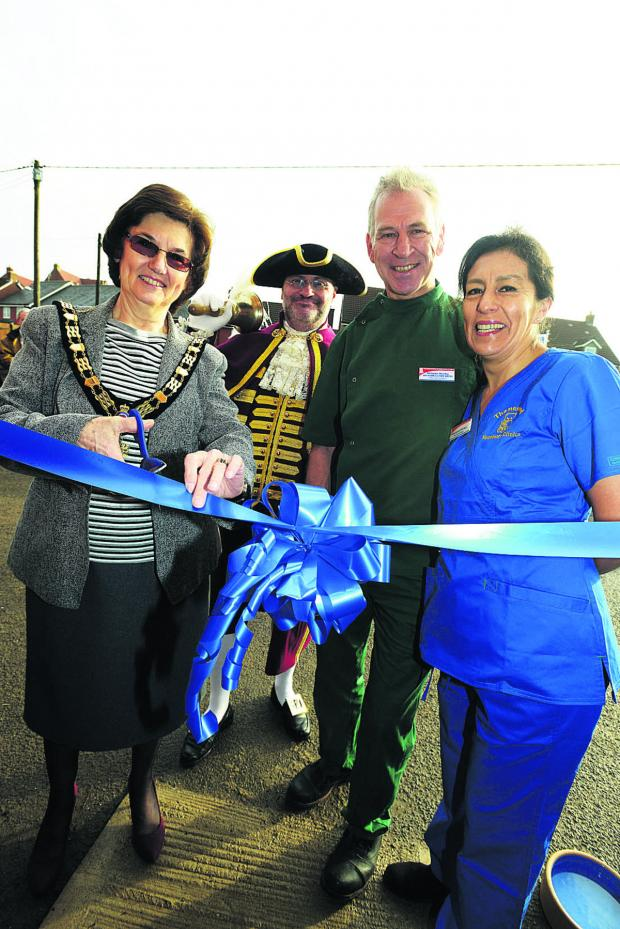 This Is Wiltshire: From left, mayor Linda Frost and town crier Owen Collier with Nicholas Hartley and Giovanna Hartley of Thamesdood Vets at the opening. Picture: THOMAS KELSEY