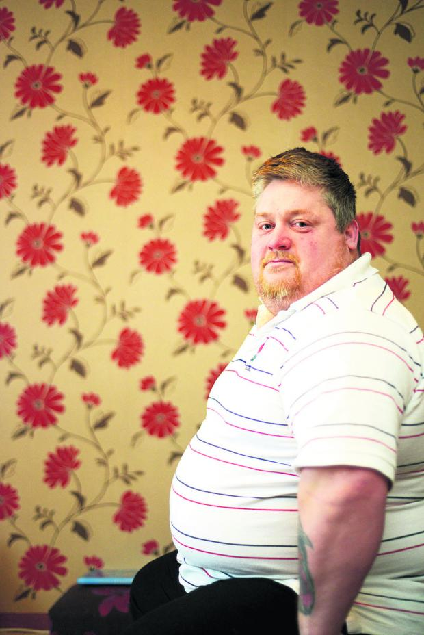This Is Wiltshire: Martin Pulling is attempting to lose 10 stone in 2014. He now weighs 23 stone. Picture: THOMAS KELSEY
