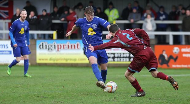 This Is Wiltshire: Chippenham's Bryan Smith in action against Weymouth on Saturday (Picture by Robin Foster)