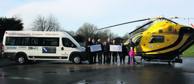 This Is Wiltshire: Wiltshire Air Ambulance, Kennet Community Transport and Avebury Cricket Club representatives receive cheques from Avebury Club