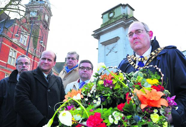 This Is Wiltshire: Attending the ceremony to mark Holocaust Memorial Day, from left, organiser Matt Holland, Rev Simon Stevenette, of Christ Church, Swindon Council leader David Renard, South Swindon MP Robert Buckland and mayor Nick Martin. Picture: DAVE COX