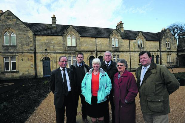 This Is Wiltshire: Trust members Richard Hillier, Jon Price from contractors Riggs, Pat Nicol, chairman John Crook, Pat Aves and Mike Sanky at the almshouses