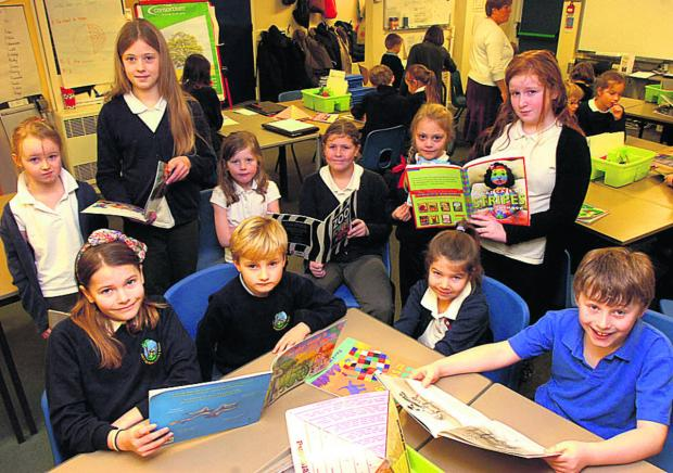 This Is Wiltshire: Front, Ellie, Oscar, Ayla, Tom, back, Olivia, Izzy, Eva, Elyssa, Alice and Courtney enjoy reading at Lea and Garsdon CE Primary School